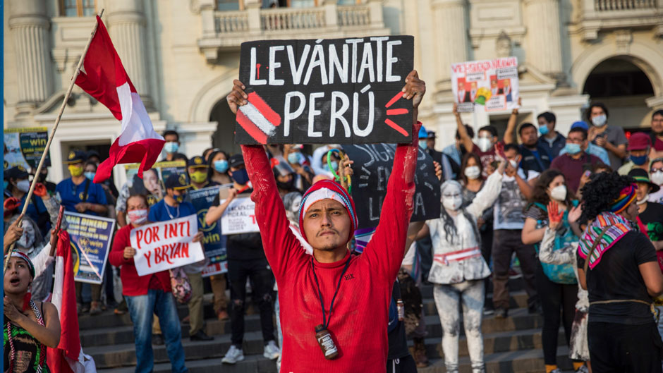 "A performer holds a sign that reads in Spanish, ""Wake up Peru"" during a protest to demand significant social changes and a new constitution from the government of new interim president Francisco Sagasti, in Lima, Peru, Saturday, Nov. 21, 2020. (AP Photo/Rodrigo Abd)"
