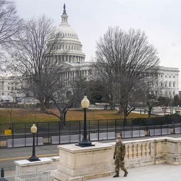 With the U.S. Capitol Building in view, a member of the military stands guard outside Russell Senate Office Building on Capitol Hill in Washington, Friday, Jan. 8, 2021, in response to supporters of President Donald Trump who stormed the Capitol. (AP Photo/Patrick Semansky)