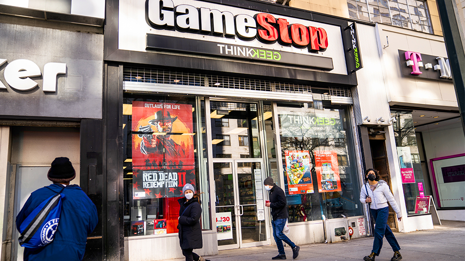 GameStop stock has rocketed from below $20 to more than $400 this month as a volunteer army of investors on social media challenged big institutions who has placed market bets that the stock would fall. (AP Photo/John Minchillo)