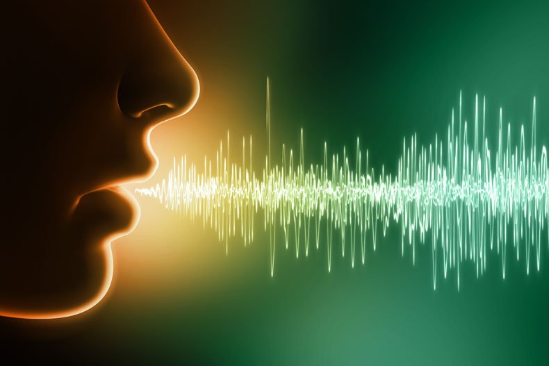 Graphic showing profile of face and speech/audio wave