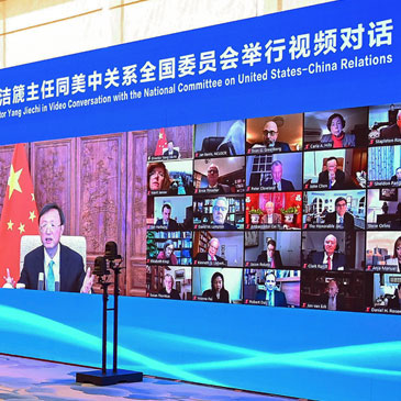 "In this photo released by Xinhua News Agency, a screen showing Yang Jiechi, head of the ruling Communist Party's office on foreign affairs, left, holds an online conversation with board members of the U.S. National Committee on United States-China Relations in Beijing on Tuesday, Feb. 2, 2021. China's top foreign policy adviser is urging closer ties with the U.S. under the Biden administration, while saying Washington must ""effectively respect China's position and concerns on the Taiwan issue."" Yang said the sides will have their differences but should not allow them to derail relations. (Li Xiang/Xinhua via AP)"
