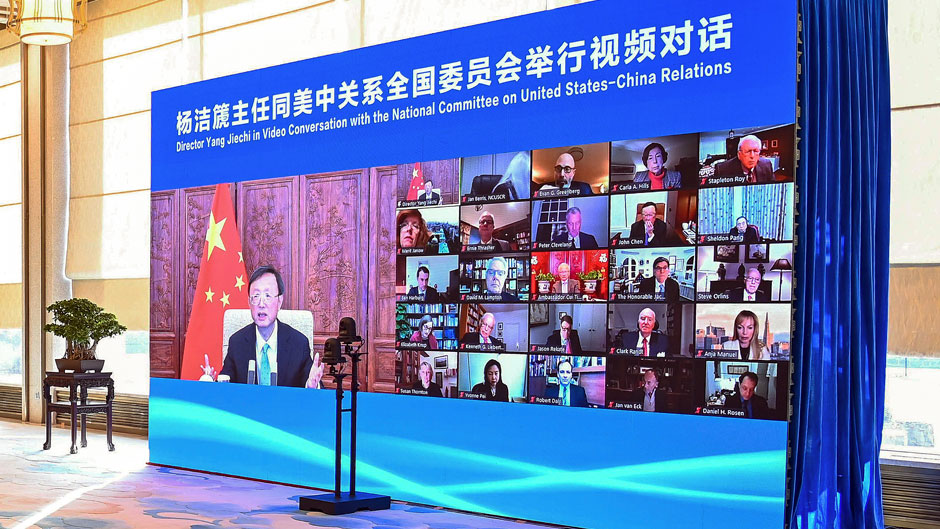 """In this photo released by Xinhua News Agency, a screen showing Yang Jiechi, head of the ruling Communist Party's office on foreign affairs, left, holds an online conversation with board members of the U.S. National Committee on United States-China Relations in Beijing on Tuesday, Feb. 2, 2021. China's top foreign policy adviser is urging closer ties with the U.S. under the Biden administration, while saying Washington must """"effectively respect China's position and concerns on the Taiwan issue."""" Yang said the sides will have their differences but should not allow them to derail relations. (Li Xiang/Xinhua via AP)"""