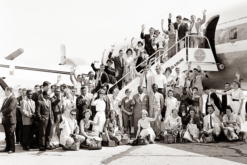 First members of the Peace Corps Volunteers to leave for overseas duty wave from the ramp of their plane at National Airport, MATS Terminal, Washington, D.C., Aug. 29, 1961. They will travel to Ghana, Africa, for teaching assignments. (AP Photo)