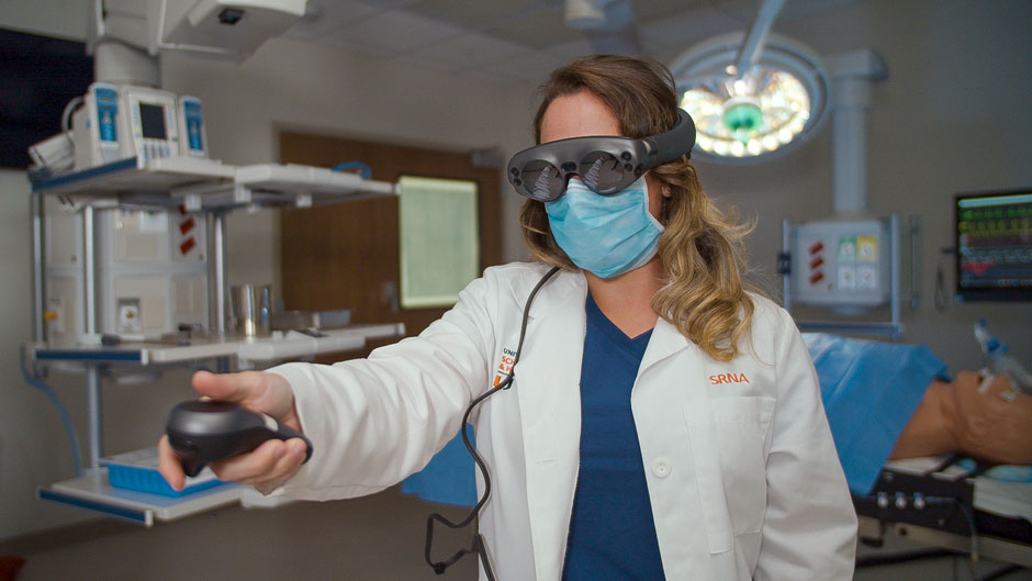 At the School of Nursing and Health Studies, faculty and students are developing an application using Magic Leap goggles to help teach nurse anesthesia students how to familiarize themselves with the operating room. Photo: TJ Lievonen/University of Miami