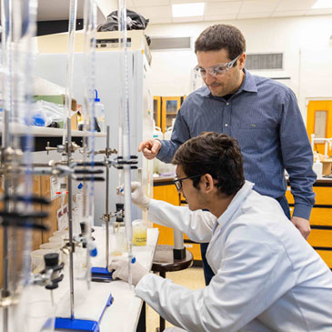Ali Ghahremaninezhad works with a graduate student in the College of Engineering. Photo from 2019.