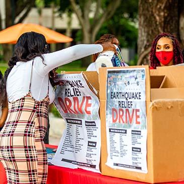 Planet Kreyol hosted a vigil to remember victims of the earthquake. Photo: Jenny Hudak/University of Miami