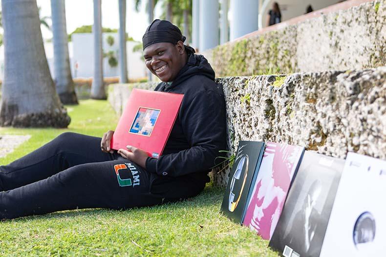 Noah Lapaix with some of his vinyl record collection. Photo: Jenny Hudak/University of Miami