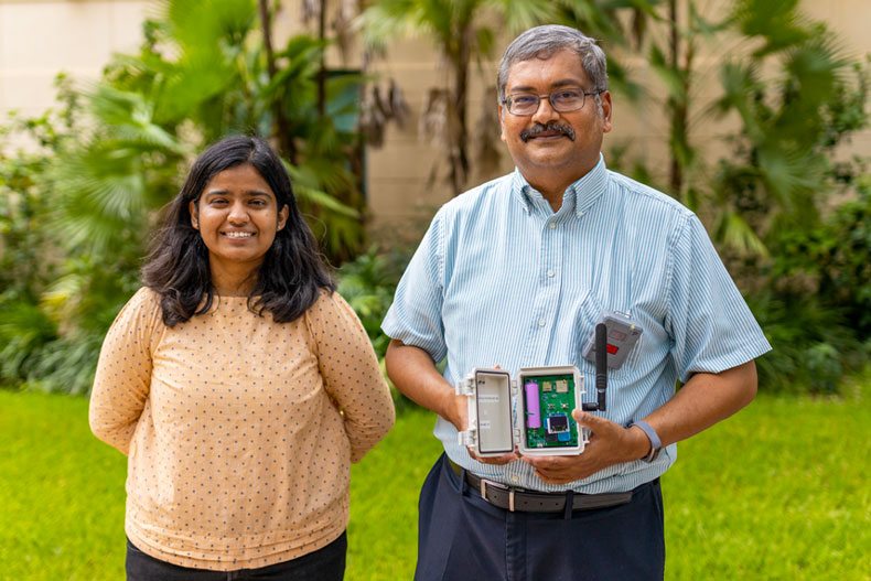 Doctoral student Shruti Choudhary, left, and Pratim Biswas, dean of the College of Engineering. Biswas holds a MAXIMA air quality sensor. Photo: TJ Lievonen/University of Miami
