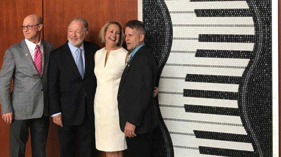 "Frost Dean Shelly Berg joins ""Piano Keys"" donors Bob Newman and Judi Prokop Newman, along with mosaic artist Doug Powell."