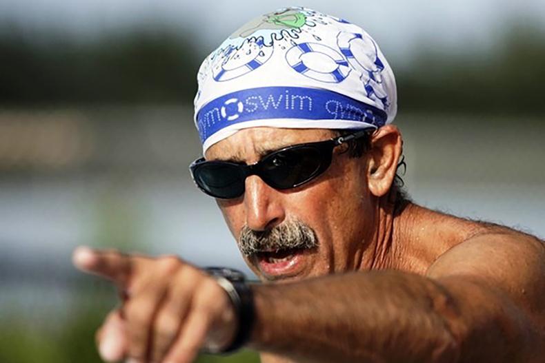 man with swim cap medium