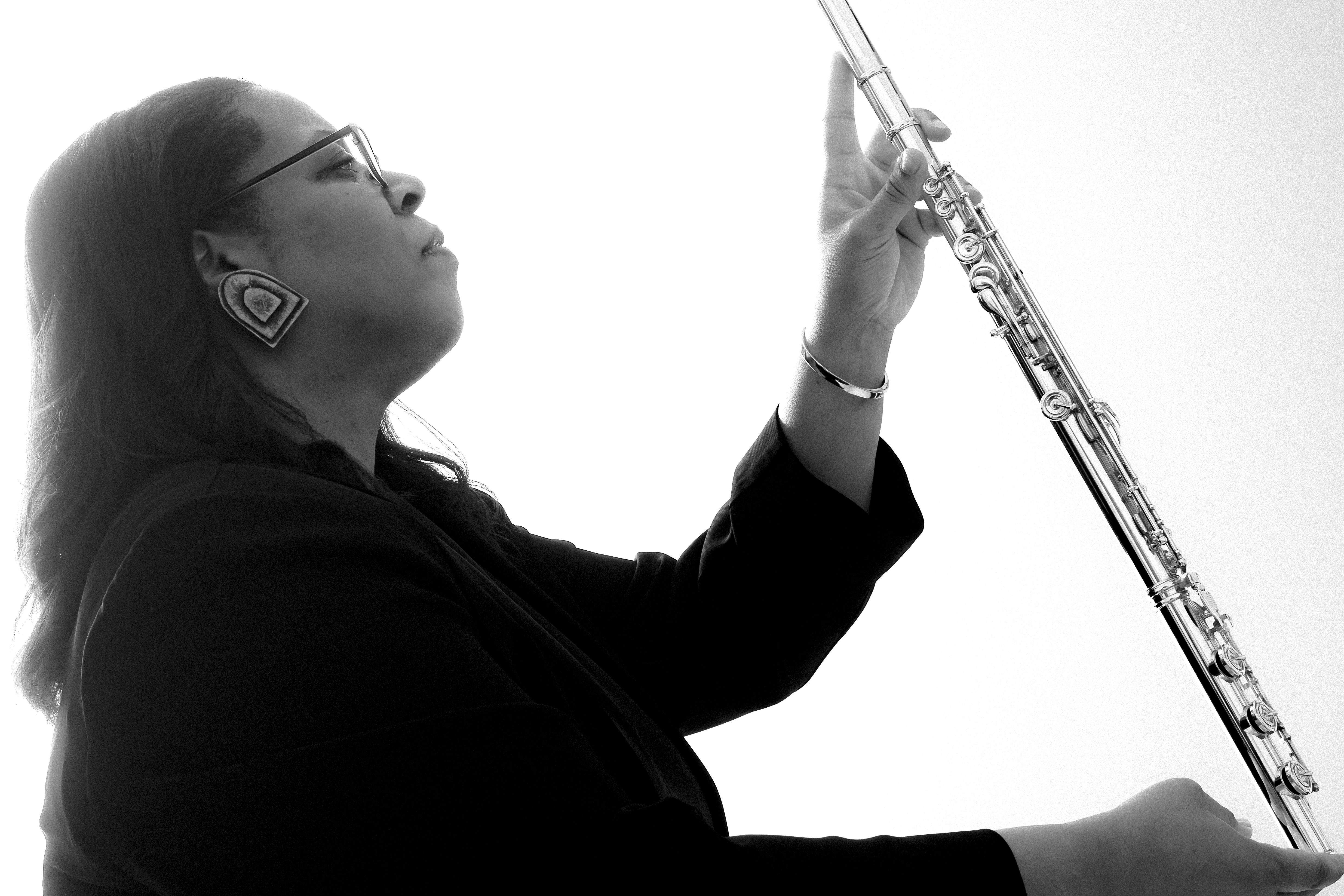 valerie coleman hold a flute and looks up