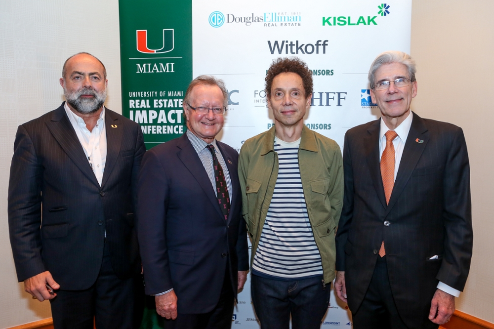 Malcolm Gladwell with UM Deans and President